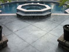 Stamped Concrete for a swimming pool? We did something different here. Instead of stamping concrete we used a colored concrete and saw cut a pattern into the concrete. I think it gives the pool a modern look. What do you think?  We sealed this concrete with an acrylic sealer using shark grip for the traction control.