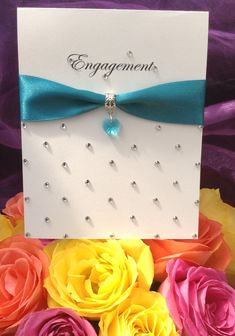 Engagement card... nice, but I would have scored diagonal lines between the gems at the bottom and layered this card onto turquoise card to frame it nicer!