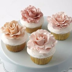 Love in Bloom Rose-Topped Cupcakes - Whether in a stunning cupcake display or individually showcased in a Wilton Cupcake Box, cause anyone's heart to skip a beat by making these rose-topped cupcakes. Making gum paste roses is easy when you use the instructions and tools in the Wilton Gum Paste Flower Cutter Set.