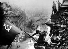 Yevgeny Khaldei's photo of Soviet soldiers raising a flag on top of the Reichstag, which was staged.