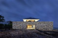 with a large gabion wall perimeter, the living areas of the house are elevated atop a private green roof yard for privacy and panoramic views. Residential Architecture, Amazing Architecture, Contemporary Architecture, Interior Architecture, Dream Home Design, Modern House Design, Gabion Wall, Villa, Cheap Home Decor