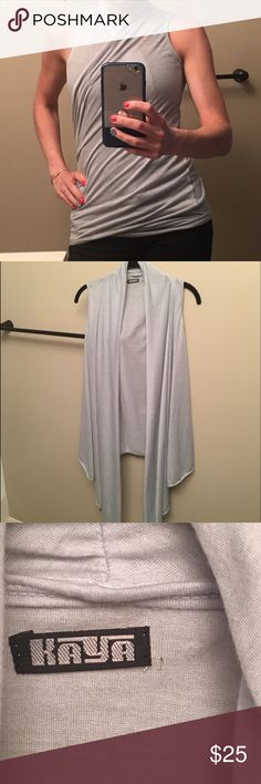 """Kaya yoga wear vest/wrap/top Multiple ways to wear it! I'm 5'8"""" & just worn straight it hangs down to my knees. Color looks grey in the yellow light of my apt but it's actually a light powder blue with a just hint of green. Very slight imperfection by the tag (shown in photo). Tops"""
