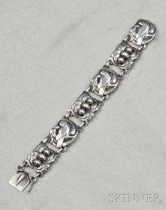 """Georg Jensen, Sterling Silver Bracelet, designed by Georg Jensen, with bird and foliage motifs, bezel-set with """"silver pearls,"""" lg. 7 1/8 in., no. 14, signed GI and Georg Jensen in a circle of dots, Denmark."""