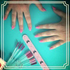 Barbie pink on gel nails.