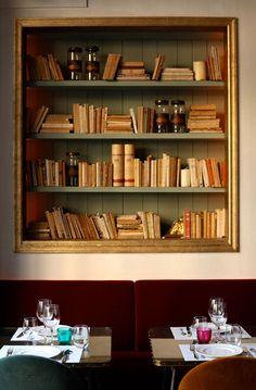 Cafe Kafka in Barcelona, built-in bookcase behind gold frame Bohemian Cafe, Cafe Design, Interior Design, Frame Shelf, Modernisme, Book Cafe, Built In Bookcase, Building Bookshelves, Unique Bookshelves