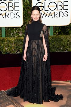 Emilia Clarke channels 1950s elegance in a black gown with cape detail.   - TownandCountryMag.com