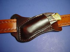 Custom leather left Hand Cross draw pocket knife sheath far a buck 110 are 112