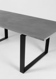 Our Concrete Alps Dining Table by Lyon Béton is sleek and minimal, with its concrete table top and black powder coated metal base, it gives the impression of lightness and provides comfortable space for legs.