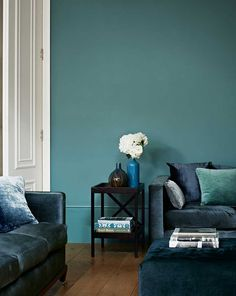 This is mono-colored living room as the main colour of this living space is blue. It looks very well-balanced however because it uses different shades and variations of blue. Teal Bedroom Walls, Teal Bedroom, Teal Painted Walls, Teal Walls, Perfect Paint Color, Luxury Paints, Wall Painting Living Room, Teal Walls Living Room, Zoffany Paint