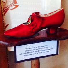 This red silk shoe was originally created in Haverhill, MA to be showcased at the 1893 Chicago's World Fair. Today, it is the model and inspiration for the Soles of Haverhill 2014 public art project, in Haverhill. From the Buttonwoods Museum Collection.