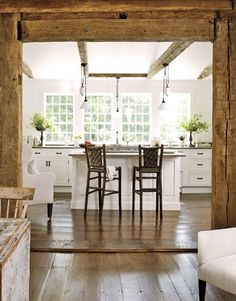 In love the barn wood beams and the white kitchen. I am also installing large windows in a white kitchen with small island. Timber Kitchen, Kitchen White, Kitchen Windows, Rustic Kitchen, Open Kitchen, Craftsman Kitchen, Floors Kitchen, Kitchen Island, Crisp Kitchen