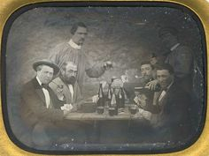 Boys-night-out in the 1850s! This one is worth zooming in on. Once the darkening is penetrated their faces and the cards they are holding can be better seen.