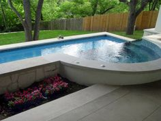 Perfect lap pool set close to the home with sloped lawn and negative edge spa. Prefer rectangular spa.