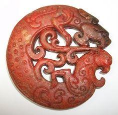 A Carved Archaic Red Jade Grain Totem, Pendant Zhou Dynasty, 475 B.C. – 221 B.C. Eastern