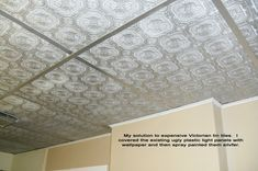 cover ugly drop ceiling panels with textured wallpaper and then spray paint paper and grids