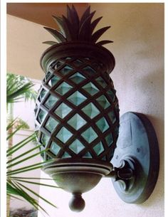 I love pineapples and the whole symbolism behind it as a gesture of a warm welcome to the home. I definitely want to incorporate it somewhere in the front, either in a wall plaque with the house address, a door ringer or maybe even the Light Fixtures! oh how I would love this one!