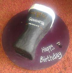 Pint anyone? Vanilla sponge cake with vanilla buttercream topped with black marshmallow fondant. Guinness cake