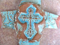 Crosses galore! #inspiration #faith #hope #clay #ceramic #homedecor #art #wallhanging #ranchdecor #stamped #scroll #crosses #handmadecrosses #rustic  SOLD