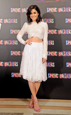 Vanessa Hudgens looks stunning in a white lacy crop top and matching skirt.