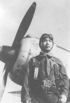 """The JAAF's 'Ace of Aces' in World War 2, MSgt Satoshi/Satoru Anabuki posing in front of a Ki-43-IIIas at the Akeno fighter school where he was an instructor from Feb 1944 till late '44/Early 45.His parachute harness is a Type 92 whilst the white identification label on the strapping itself reads 'MSGT Anabuki'. Despite being dressed in a summer suit, the """"Flower of the Youth Flyers"""" is inexplicably wearing a winter flying helmet. The bandaged left hand is a result from his 8 Octo..."""
