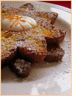 Orange French Toast made with panattone. I would probably drizzle with reduced orange juice. Mmmm