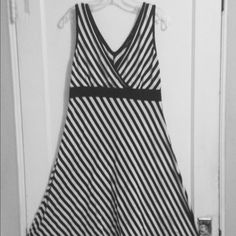 Black and white striped dress This is a very soft and comfortable tank dress black and white stripes by New York & Company. Empire waist; Size large. Great with a jacket and heels or throw over a bathing suit New York & Company Dresses Midi
