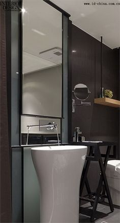 Crisp Clean bathroom - swinging shelf in wall facet