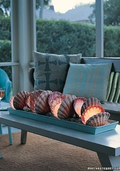 DIY Décor ● Oversized Shell Tealight Centerpiece-great idea for keeping the breeze from blowing out the candles :)