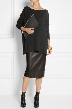 Like: everything - midi length faux leather skirt; oversized long sweater and black ankle boots