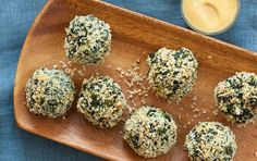 Spinach, bread crumbs(use pork rinds)and parmesan cheese make these easy appetizers quick to throw together. Shape ahead and freeze beforehand (for up to 2 weeks), if you prefer, adding 5 to 10 minutes to the baking time.