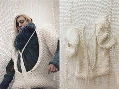 Wearing a sweater knitted into the wall by Isabel Berglund
