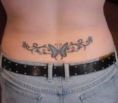 Beautiful art surrounds this butterfly lower back tattoo THIS IS ON MY BACK AND NEEDS COLORING