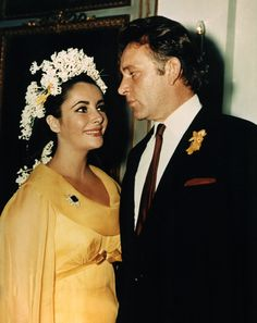 Elizabeth Taylor - This violet-eyed English actress wed Richard Burton (for the first time) in 1964 with flowers crowning her face and hyacinths twisting down her fall.