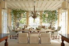 Frank Pontero indoor/outdoor dining room. Love the paneled ceiling, chandelier and burlap covered lights