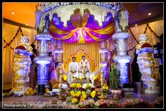 groom eagerly awaits the arrival of his bride to the ceremonial stage,