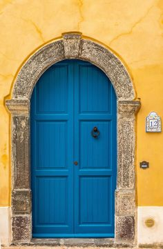 Blue door in Salina, Sicily, Italy