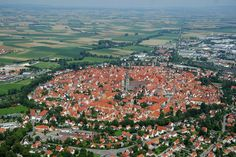 Nordlingen, Germany.... built on a meteorite crater.... with the medieval wall surrounding the town still in tact - also in the elevator scene of Willy Wonka and the Chocolate Factory.