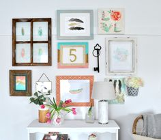 How to create a gallery wall collage using picture frames and personal items. Mix old and new, vintage and modern, and even fresh flowers.