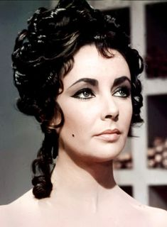 Elizabeth Taylor on the Set of Cleopatra, 1963. Description from pinterest.com. I searched for this on bing.com/images