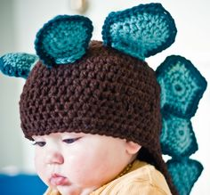 This crochet dinosaur hat is just too cute.You could even change how those spikes look to make a different kind of dinosaur. Maybe horns?