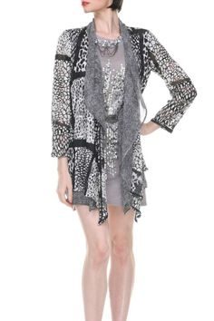 This open front lightweight jacket has a waterfall front and a double layer - a light chiffon in a black/ivory abstract print overlaid with a mesh black and ivory patchwork of animal prints.   Animal Print Jacket by Aris A.. Clothing - Jackets, Coats & Blazers - Jackets California