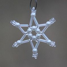 Christmas snowflake beaded white and Pearl ornament made of beads Beaded Christmas Decorations, Christmas Ornaments To Make, Snowflake Ornaments, Christmas Snowflakes, Beaded Ornaments, How To Make Ornaments, Christmas Crafts, Diy Ornaments, Felt Christmas