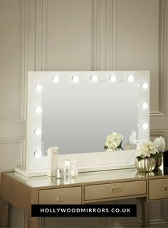 Hollywood Mirror In White Gloss | Makeup Mirror with Lights | Dressing Table Mirror with Lights | Vanity Mirror with Lights | Illuminated Makeup Mirror | Holllywood Mirror UK | Light Up Makeup Mirror | Hollywood Mirrors | Mirror Size 80 X 110cm | https://www.hollywoodmirrors.co.uk/products/makeup-mirror-with-lights-around-it Our popular white gloss makeup mirror with lights around can be freestanding on your dressing table! Create flawless beauty looks under our perfect illuminating mirror.