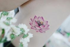Lotus flower and diamond tattoo by Tattooist Banul