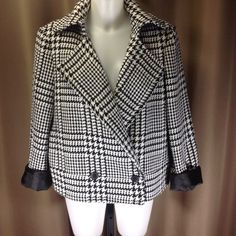 "Liz Claiborne houndstooth jacket Classic black and white woven houndstooth jacket. Fully lined in black, double button closure, on-seam pockets. Measures 24"" shoulder to hem, 22"" across bust front, 23"" across bottom hem front. Size XL Liz Claiborne Jackets & Coats"