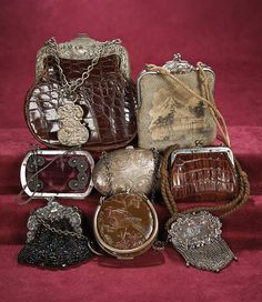 Collection of Eight Silver-Framed Early Purses. Mid/late 19th century. http://Theriaults.com