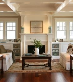 Wall with built-in bookcases under windows on either side of fireplace - from Asher Associates Architects, via Houzz