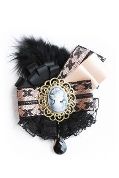 """Feather """"Fake Diamonds"""" Brooch from Romwe - Lace, ribbons, cameo, a tear drop bead and a feather why not; Both complex enough to look like a treasure and monochromatic enough to not overwhelm the senses."""