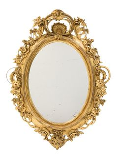 A LOUIS XV STYLE GILT GESSOED MIRROR : Lot 298