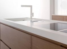 Simple White Cesarstone Countertops - fresh and easy. I love the white without any texture or flecks of color so it looks really modern.